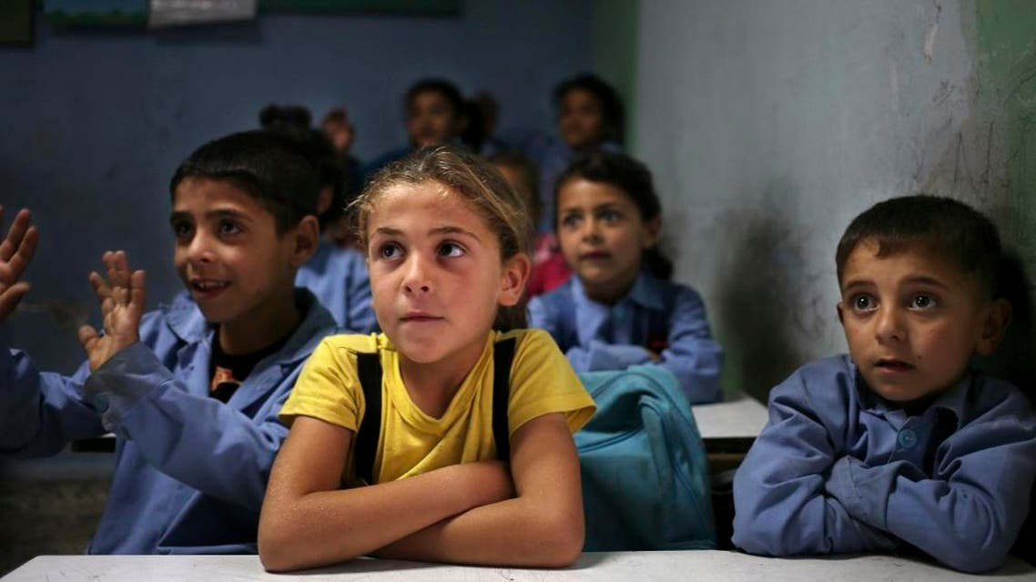Syrian refugee students sit in their classroom at a Lebanese public school where only Syrian students attend classes in the afternoon in Kaitaa village in north Lebanon. (File: AP)