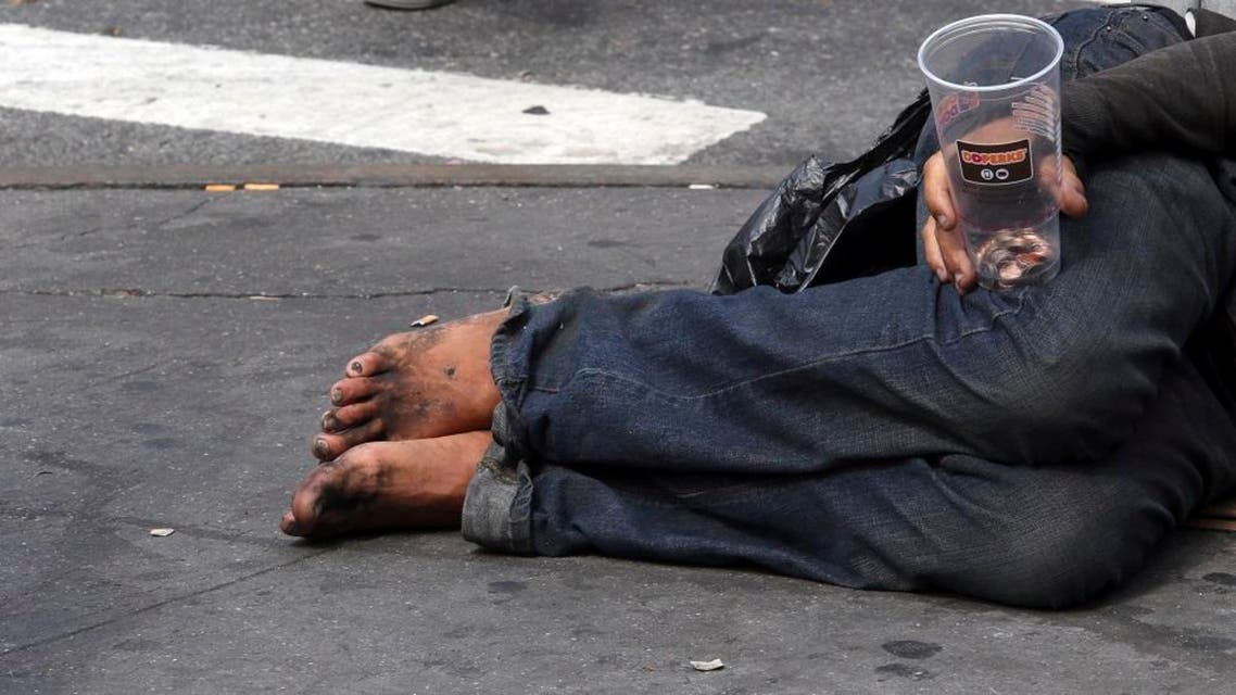 """A homeless man asks for money on 14th Street, Friday, Sept. 4, 2015, in New York. The number of homeless on New York City's streets has increased, prompting breathless media coverage and worries that the """"bad old days"""" are returning to the Big Apple. (AP Photo/Mary Altaffer)"""