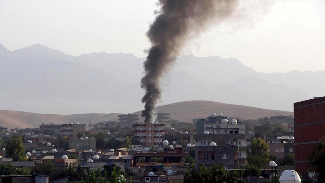 Smoke billows from a fire during firefight between the police and Kurdistan Workers' Party, or PKK militants in the town of Silopi, southeastern Turkey, Friday, July 7, 2015. Police clashed with supporters of a Kurdish rebel group in southeastern Turkey on Friday in a four-hour gunfight that killed three people, Turkey's state-run news agency reported. Violence has flared between the autonomy-seeking PKK, and Turkey's security forces in the past two weeks, wrecking an already fragile peace process between the government and the rebels. (Mehmet Selim Yalcin/Dogan News Agency via AP)