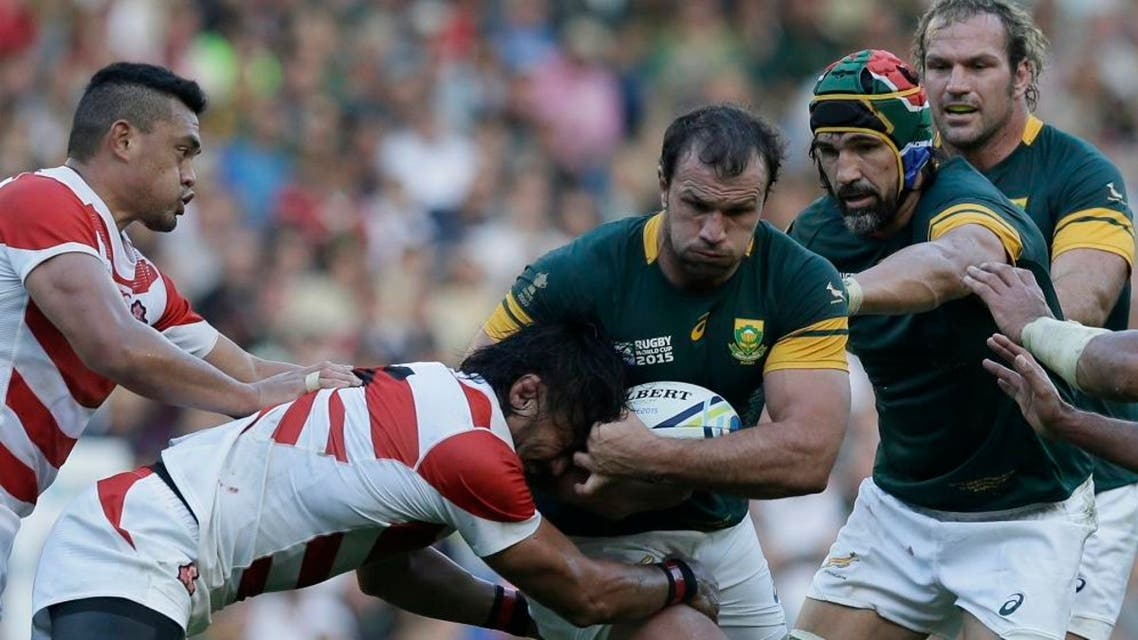 South Africa's Bismarck Du Plessis is tackled for the ball during the Rugby World Cup Pool B match between South Africa and Japan at the Brighton Community Stadium, Brighton, England Saturday, Sept. 19, 2015. (AP Photo/Tim Ireland)