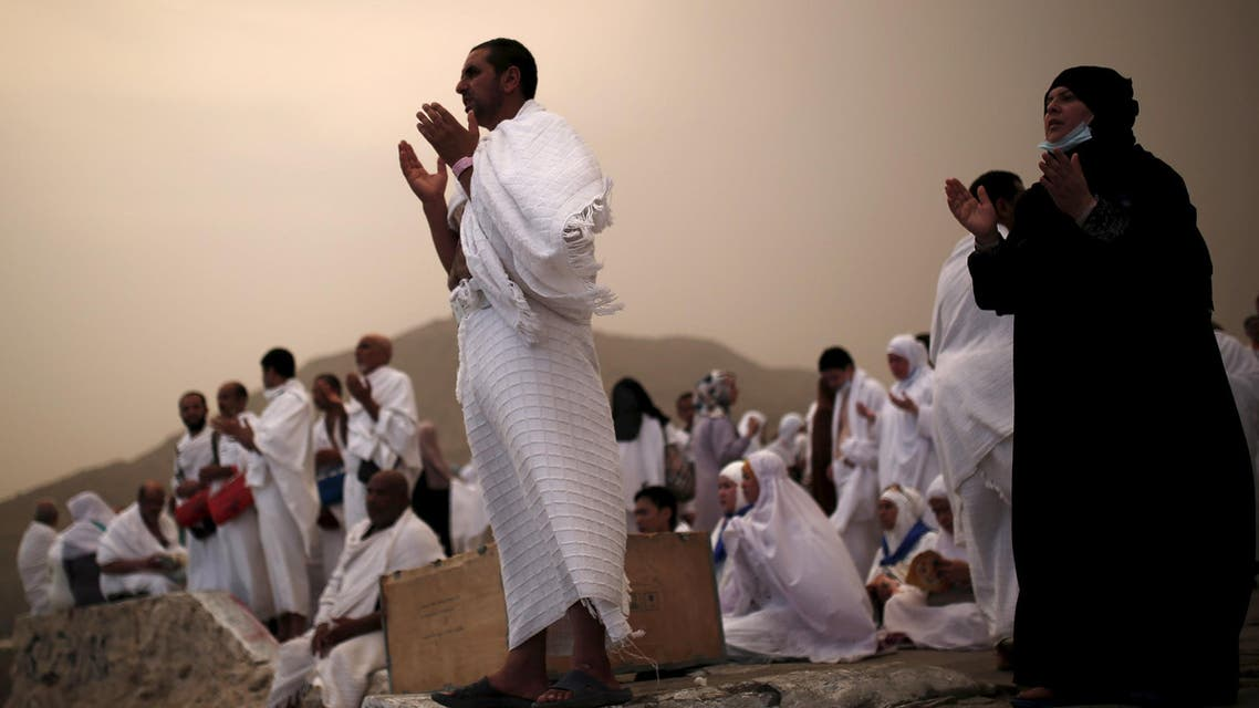 Muslim pilgrims pray on Mount Mercy on the plains of Arafat during the annual haj pilgrimage, outside the holy city of Makkah on September 22, 2015. (Reuters)