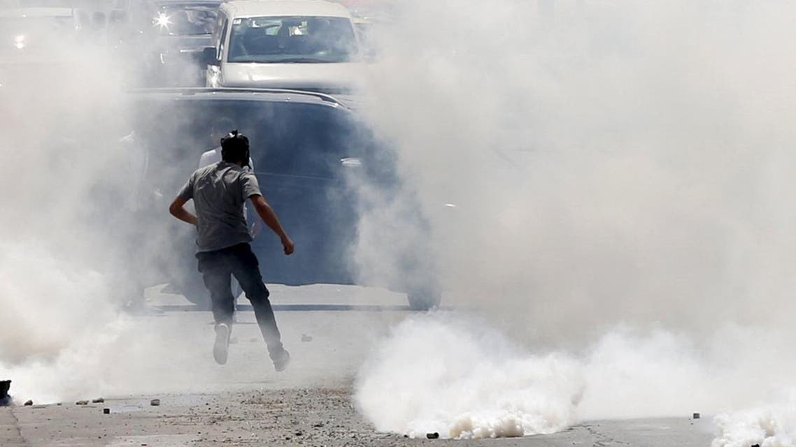 A Palestinian protester runs from tear gas fired by Israeli troops during clashes in the occupied West Bank city of Bethlehem, Sept. 21. (Reuters)