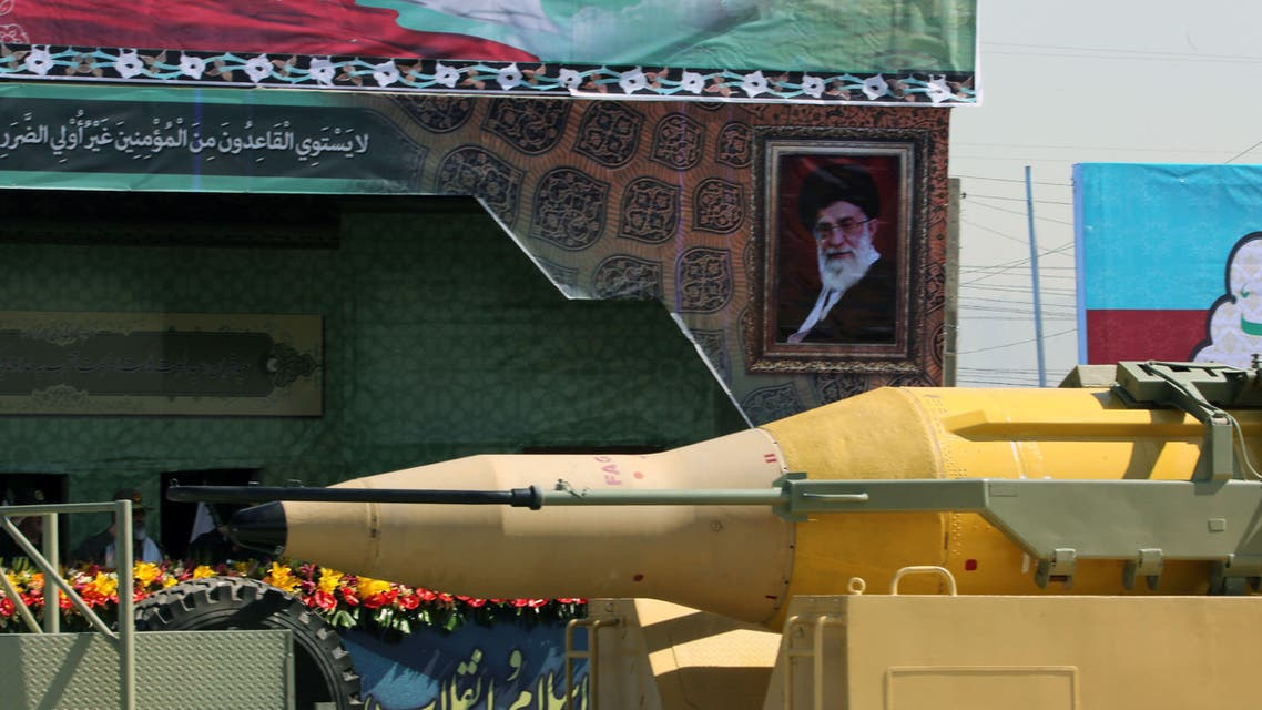 AK011 - Tehran, -, IRAN : A military truck carries a Qadr medium-range missile past a portrait of Iranian supreme leader, Ayatollah Ali Khamenei, during the annual military parade marking the anniversary of the start of Iran's 1980-1988 war with Iraq, on September 22, 2015, in the capital Tehran. AFP PHOTO / ATTA KENARE