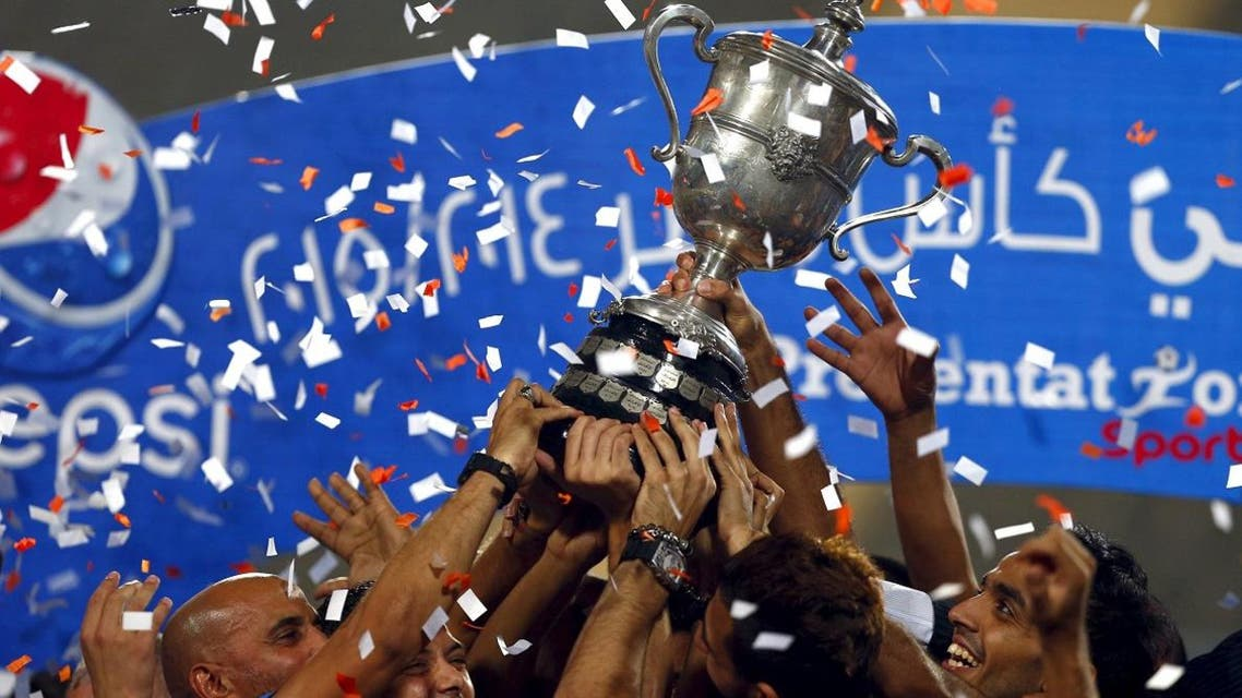 Zamalek celebrate with the trophy after winning their Egyptian Cup finals derby soccer match against Al Ahly at Petro Sport stadium in Cairo