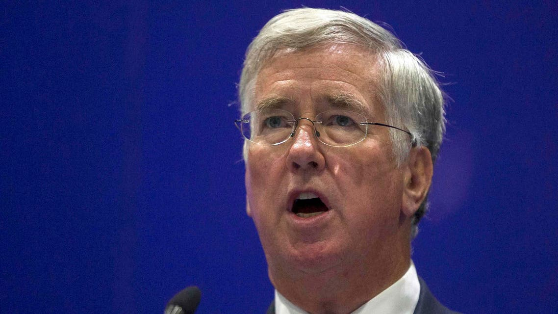 Britain's Secretary of Defence Michael Fallon delivers a speech at the Defence and Security Equipment International trade show in London, Britain September 16, 2015. REUTERS/Neil Hall