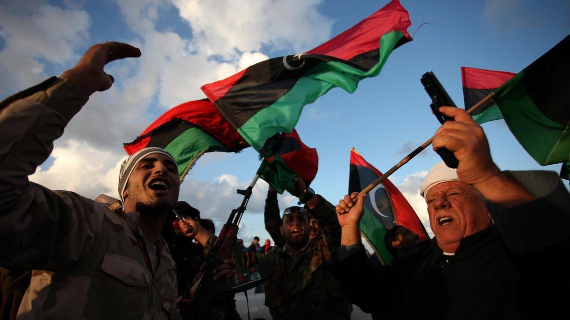 Libyans wave national flags as they chant pro-revolutionary slogans during commemorations to mark the second anniversary of the revolution that ousted Moammar Gadhafi in Benghazi, Libya, Friday, Feb, 15, 2013. (AP)