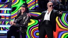 Carlos Santana, Pitbull in pro-immigrant song