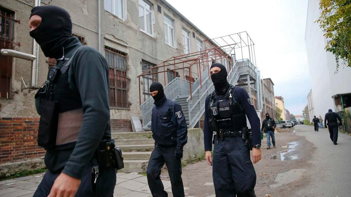 German special police members walk near a mosque association property in Berlin. (Reuters)