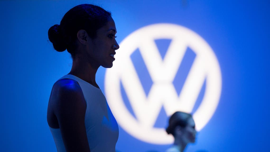 Greeters stand by during a reveal event for the new Volkswagen Passat at the Brooklyn Navy Yard, Monday, Sept. 21, 2015, in New York.