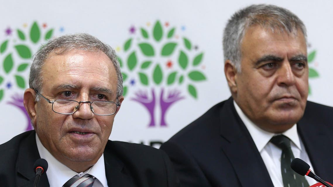 "178 - Ankara, Ankara, TURKEY : Turkey's Minister for EU Affairs Ali Haydar Konca (L) and Development Minister Muslum Dogan hold a press conference at the headquarters of the Peoples' Democratic Party (HDP) headquarters in Ankara on September 22, 2015, after resigning from the interim government. The two Kurdish ministers accused Turkey's government of promoting a ""logic of war"" as they quit the cabinet on September 22, two months after the resumption of fighting between the army and Kurdish rebels. AFP PHOTO / ADEM ALTAN"
