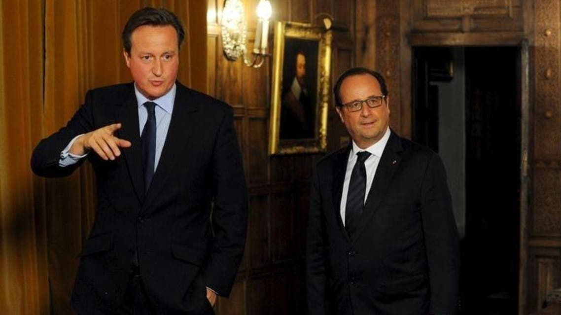 Britain's Prime Minister David Cameron (L) shows France's President Francois Hollande around the Great Room at the Chequers, during a bilateral meeting and working dinner, in London. (Reuters)