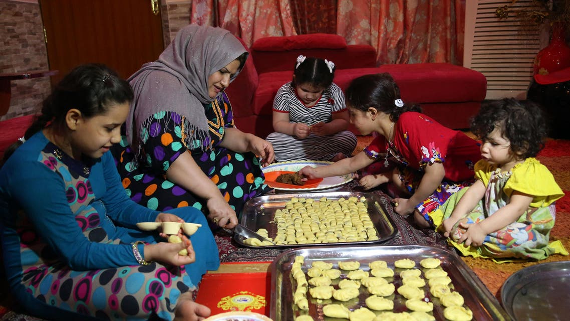 An Iraqi mother and her children prepare Eid cookies for the upcoming Muslim Eid al-Adha holiday in Basra, 340 miles (550 kilometers) southeast of Baghdad, Iraq, Tuesday, Sept. 22, 2015. AP