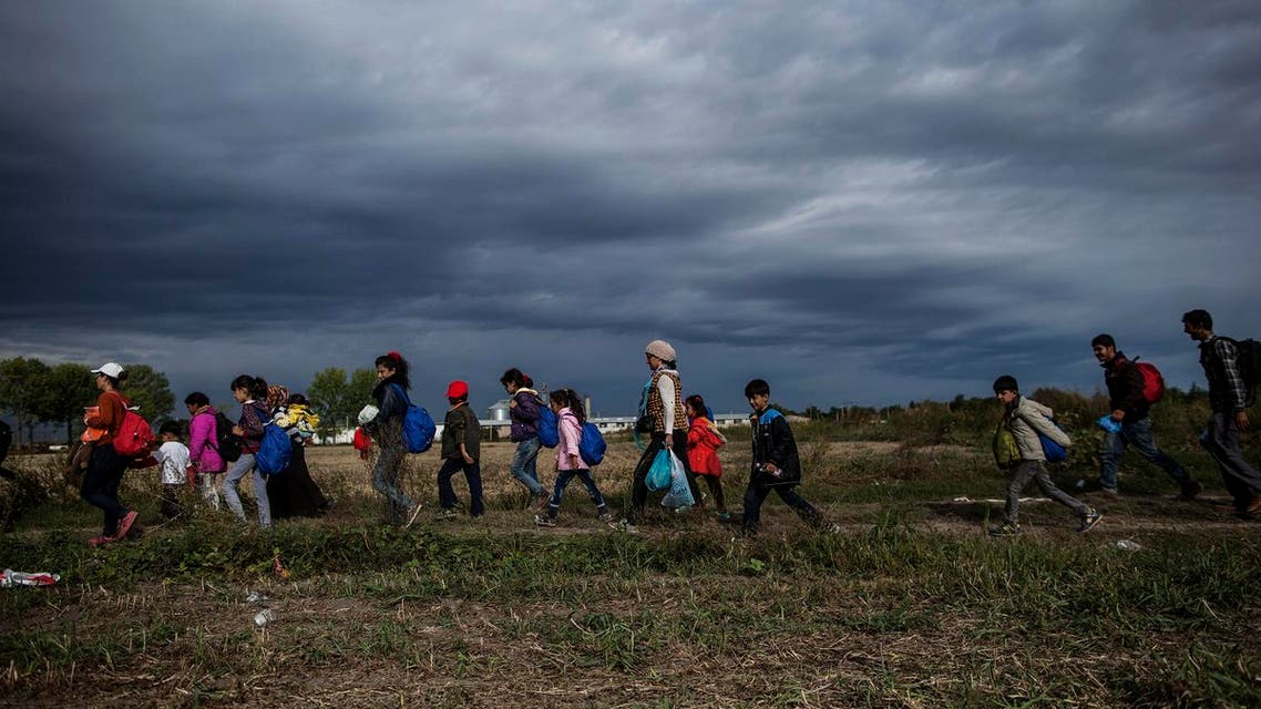 Refugees and migrants walk towards the station in Tovarnik, Croatia, Sunday, Sept. 20. (AP)