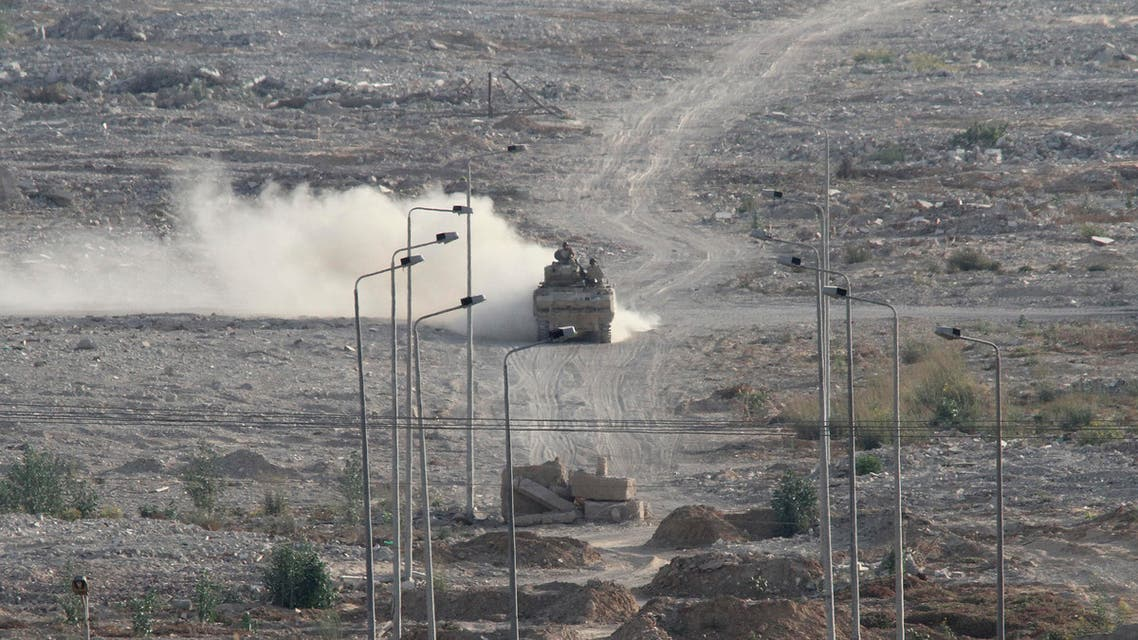 An Egyptian military personnel carrier patrols on the Egyptian side of the border between Egypt and Rafah in the southern Gaza Strip, Wednesday, July 1, 2015. AP