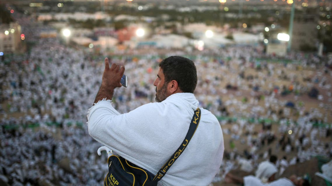 A Muslim pilgrim takes a photo with his mobile phone from atop a rocky hill called the Mountain of Mercy, on the Plain of Arafat, near the holy city of Mecca, Saudi Arabia, Wednesday, Sept. 23, 2015. AP