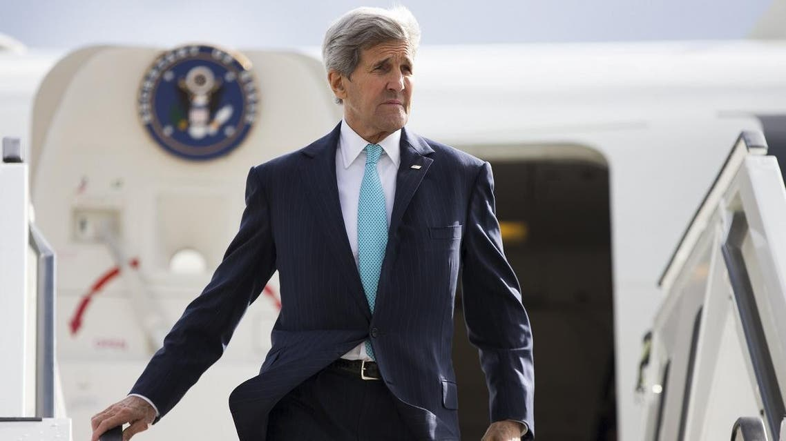 U.S. Secretary of State John Kerry steps off his plane after arriving at Berlin Tegel Airport, ahead of a meeting with Germany's Foreign Minister. (Reuters)