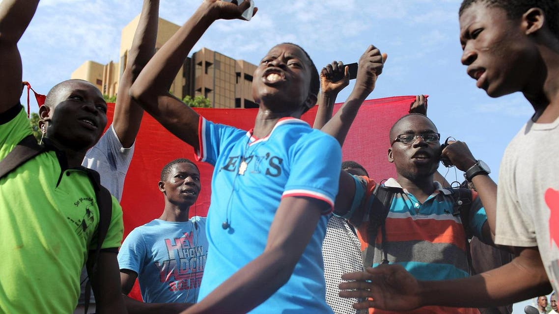 Anti-coup protesters sing the Burkinabe national anthem in Ouagadougou, Burkina Faso on Sept. 22. (Reuters)