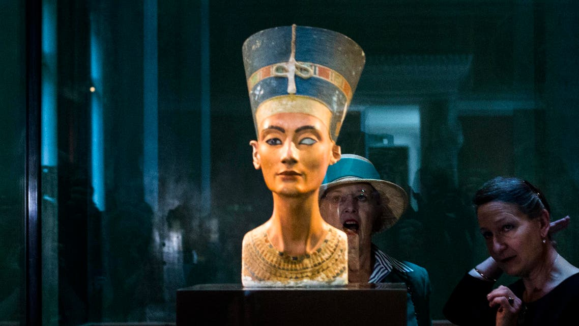 Queen Margrethe II. of Denmark, rear left, listens to Friederike Seyfried, Director of the Egypt Museum Berlin as she looks to the Nefertiti during her visit at the New Museum in Berlin, Wednesday, Sept. 10, 2014. (AP)