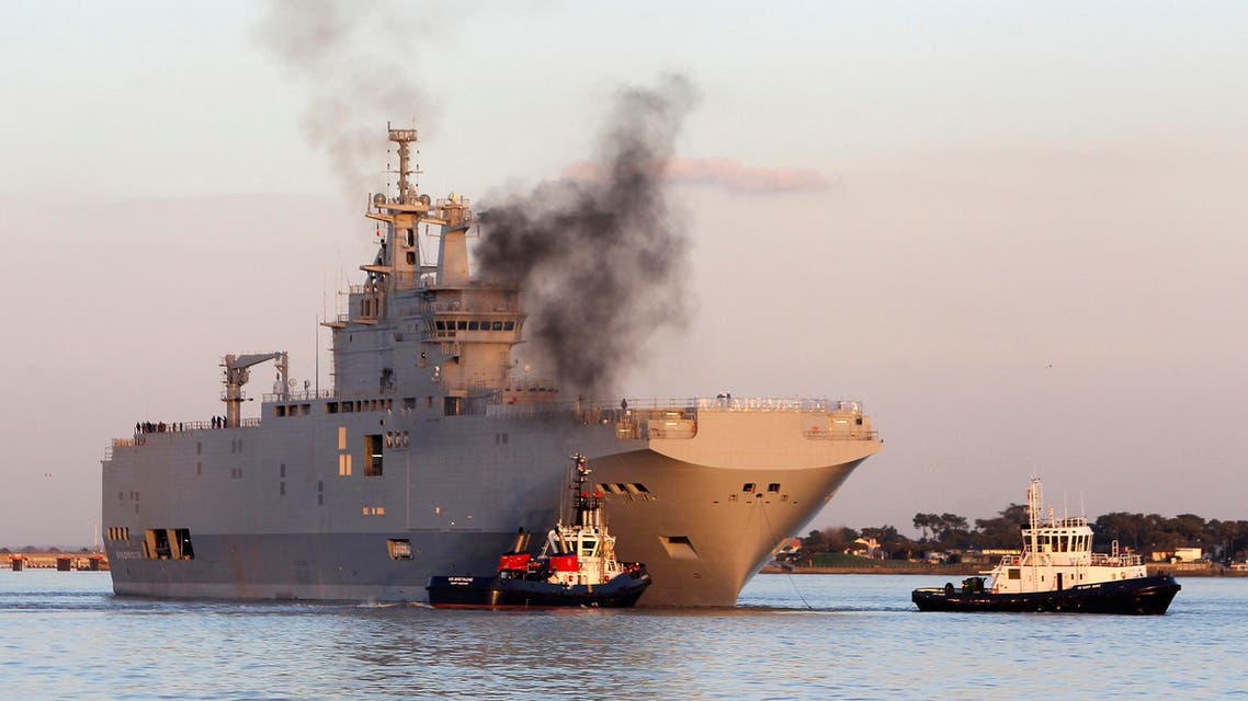 In this March 5, 2014 file photo, French-built warship BPC Vladivostock, designed to strengthen Russia's ability to deploy troops, tanks and helicopter gunships, leaves the Saint Nazaire's harbor, western France. France says Wednesday Sept.23, 2015 AP