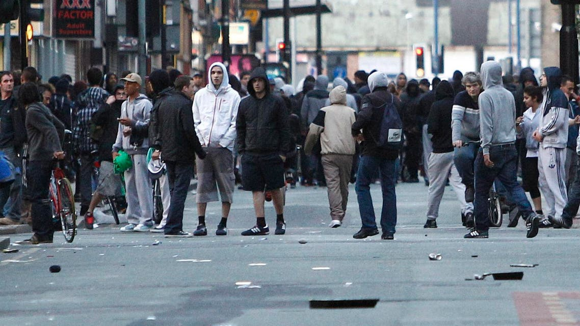 A file photo showing crowds standing in a Manchester street during the 2011 riots. (AP)