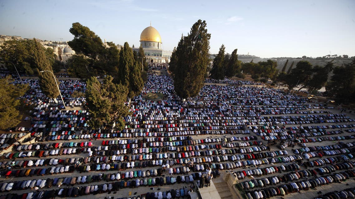 Palestinians pray during the Muslim holiday of Eid al-Adha, near the Dome of the Rock Mosque in the Al Aqsa Mosque compound in Jerusalem's old city, Thursday, Sept. 24, 2015. Muslims will slaughter cattle and goats later, with the beef and meat distributed to the needy in the holiday which honors the prophet Abraham for preparing to sacrifice his son on the order of God, who was testing his faith. (AP Photo/Mahmoud Illean)