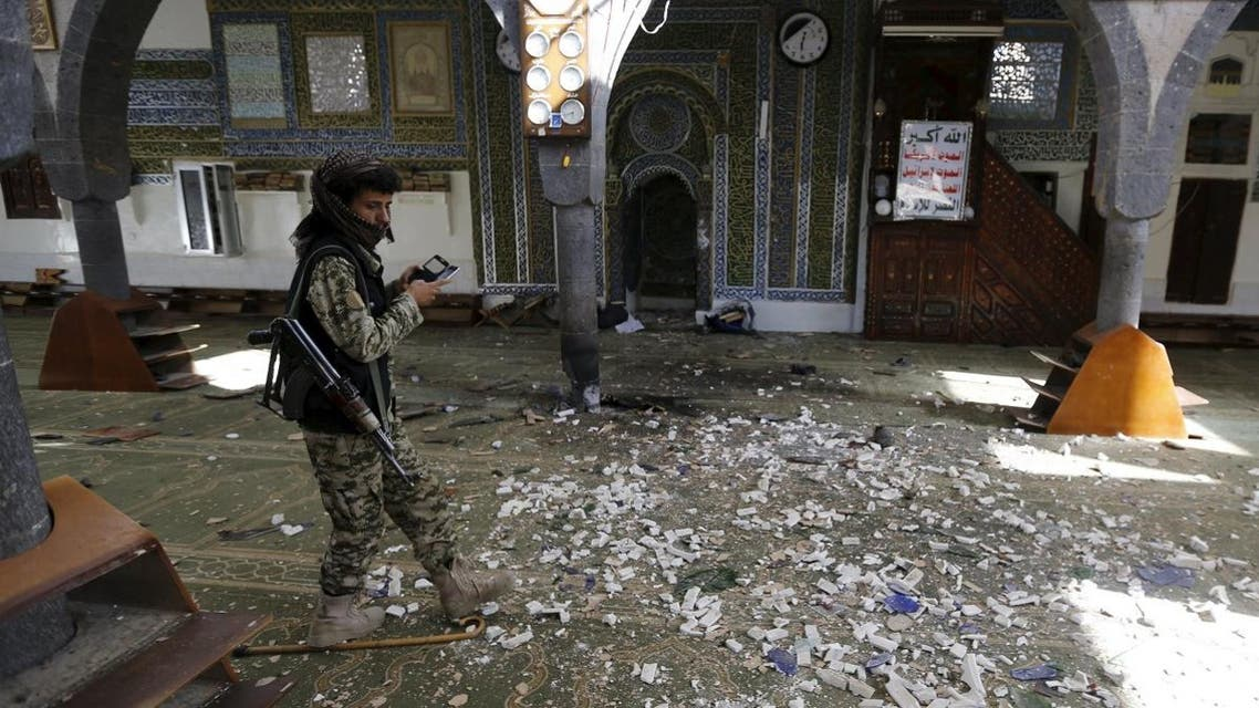 Houthi militant walks inside the al-Balili mosque after two bombings hit the mosque in Yemen's capital Sanaa. (Reuters)