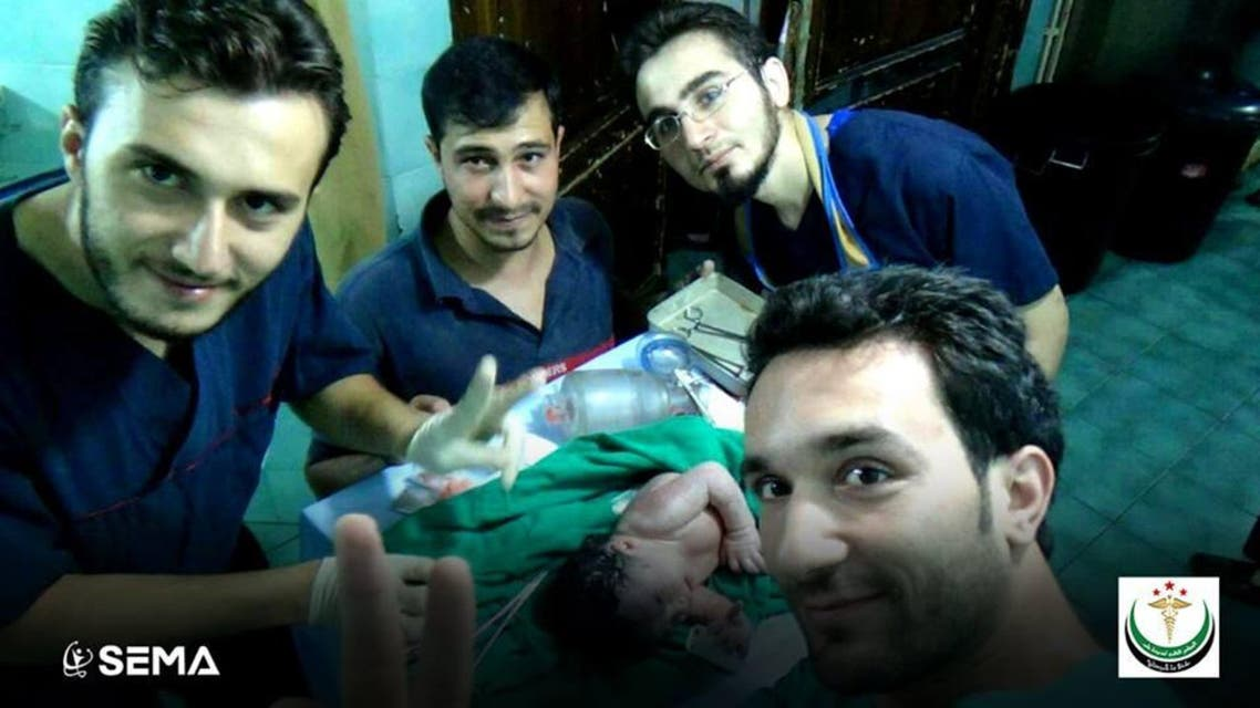SEMA doctors taking a picture with the new born baby girl after removing the shrapnel from her brow. (Photo courtesy: Facebook/SEMA)