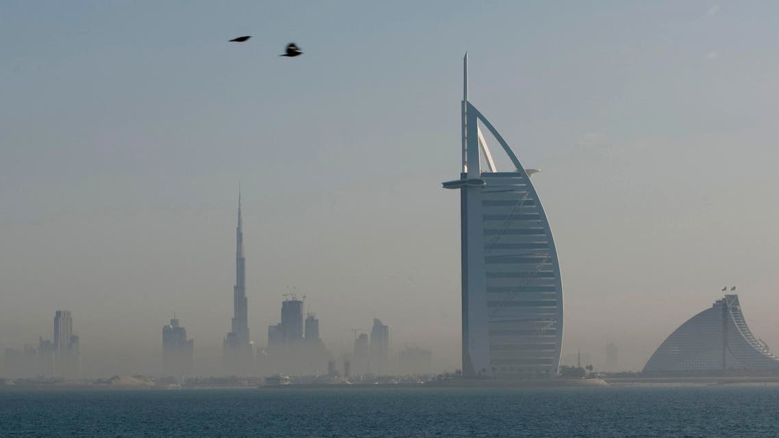The Burj al-Arab as see from the Palm Jumeirah in Dubai. The Burj Khalifa, the world's tallest building, can be seen in the distance  (Reuters)