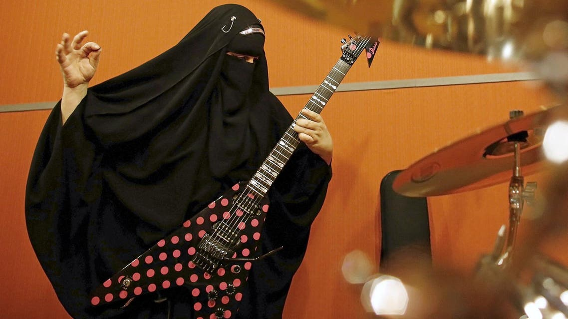 Gisele Marie, a Muslim woman and professional heavy metal musician, plays her Gibson Flying V electric guitar during a rehearsal at a studio in Sao Paulo January 27, 2015.  (Reuters)