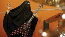 Meet Marie, the burqa-wearing Muslim heavy metal guitarist
