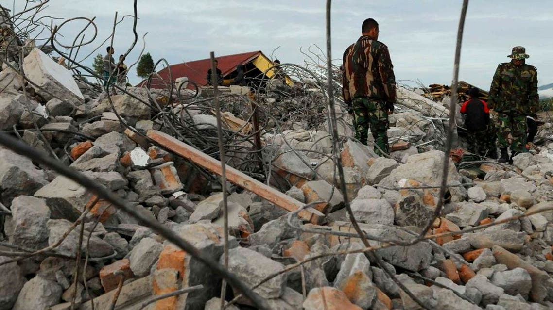 Rescuers search for victims after an earthquake in Ketol, Central Aceh, Indonesia, Wednesday, July 3, 2013. ap