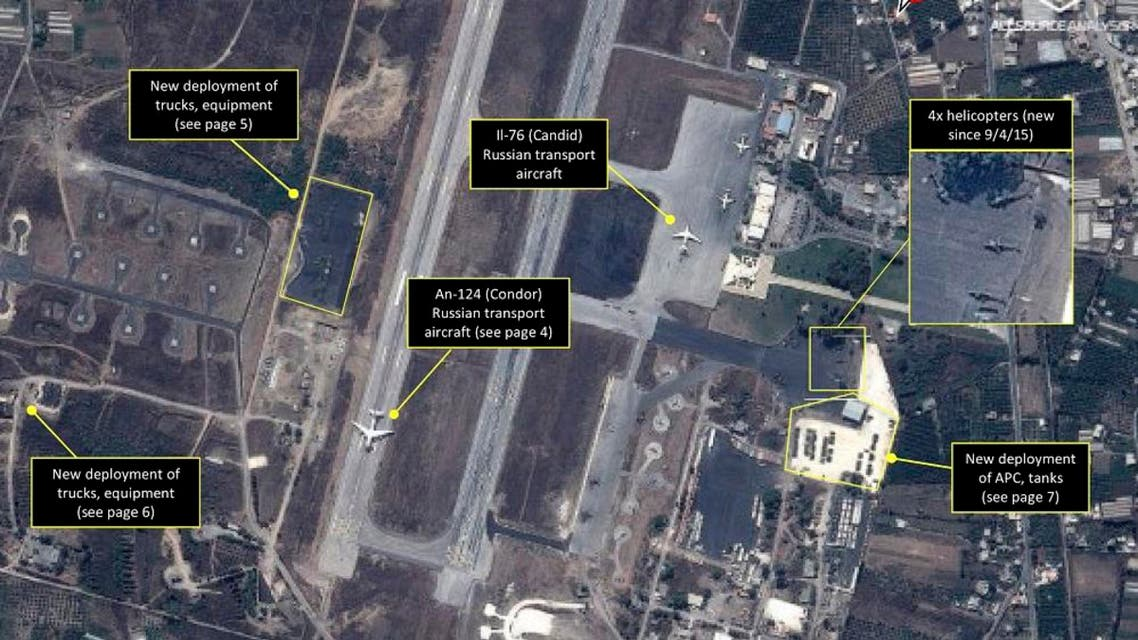 """This September 2015 satellite image with annotations provided by GeoNorth, AllSource Analysis, Airbus shows Russian transport aircraft, helicopters, tanks, trucks and armed personnel carriers at an air base in Latakia province, Syria. Russia on Thursday, Sept. 17, strongly urged the United States and its allies to engage the Syrian government as a """"partner"""" in the fight against the Islamic State group, and offered to share any information about its military supplies to Damascus with Washington. (GeoNorth, AllSource Analysis, Airbus via AP)"""