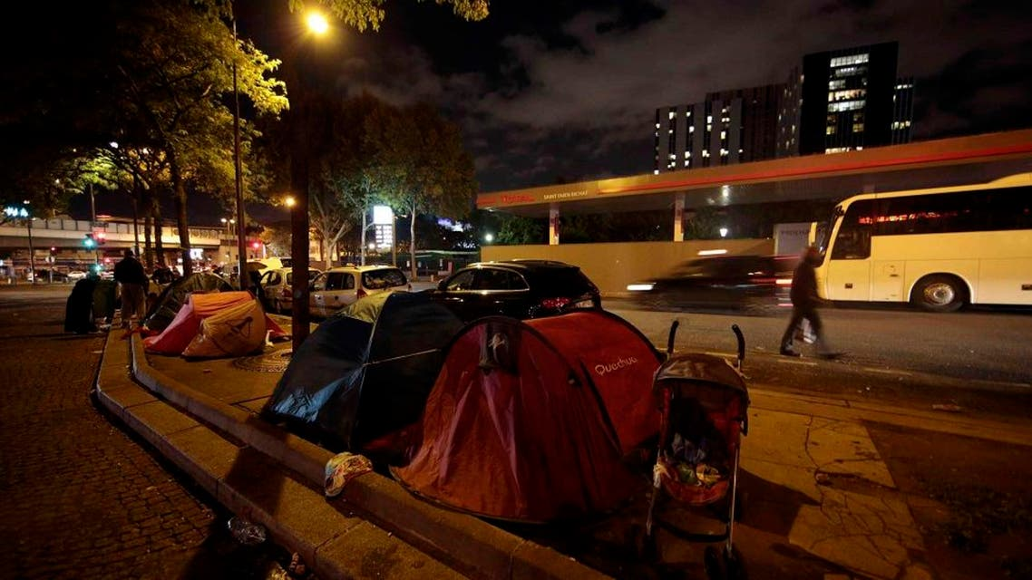 A view shows tents at a makeshift camp on a street where Ehab Ali Naser, a 23 year-old Syrian refugee, lives, in northern Paris, France, September 16, 2015. Ehab, in Paris for a month, arrived after an 18-month journey that started in his hometown of Homs, Syria, where he was a vendor at the souk. He spent a year in Lebanon, then travelled to Algeria and Morocco before he arrived in the Spanish port of Melila, and then headed to France. Currently he lives in a tent in a small refugee camp along a busy boulevard on the outskirts of Paris. Ehab has always dreamt of becoming a singer and one day his path crosses with that of a French producer, writer and composer visiting the refugee camp at Porte de Saint Ouen, who gives him the chance to try out his voice in a professional music studio. Picture taken September 16, 2015. REUTERS/Eric Gaillard