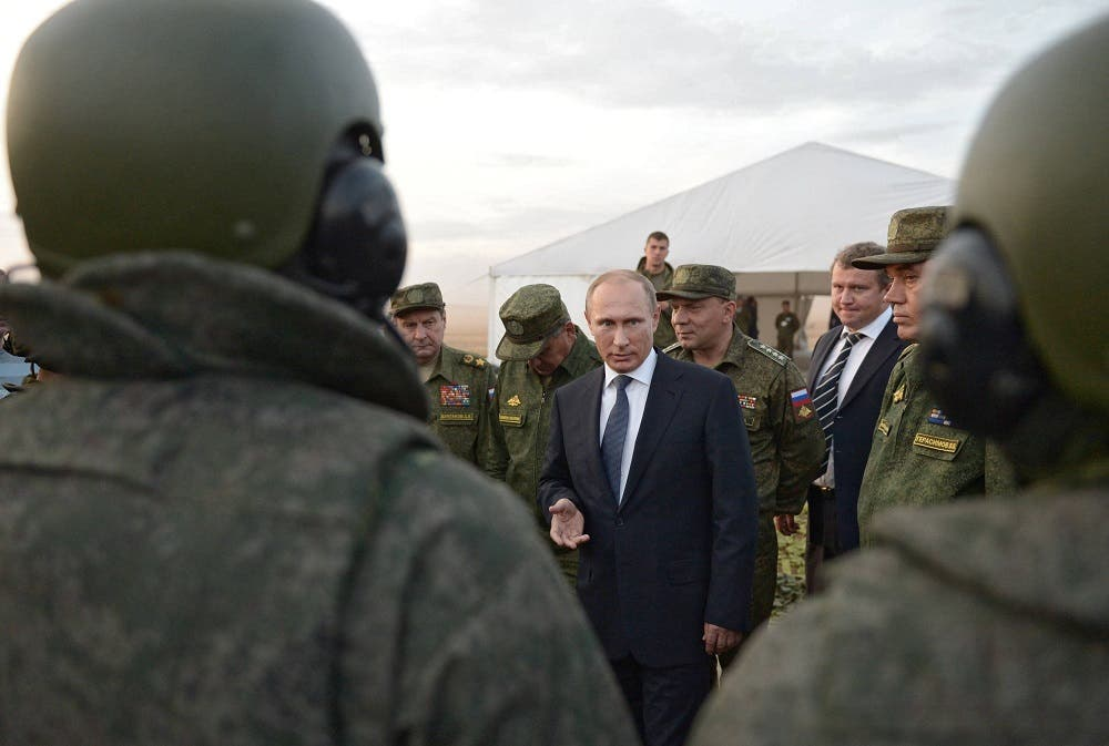 In this Saturday, Sept. 19, 2015 file pool photo, Russian President Vladimir Putin, center, meets with officers after military exercises at Donguz range in Orenburg region, Russia. With dozens of Russian combat jets and helicopter gunships lined up at an air base in Syria, Russian President Vladimir Putin is ready for a big-time show at the United Nations General Assembly. Observers expect the Russian leader to call for stronger U.N.-sanctioned global action against the Islamic State group and possibly announce some military moves in his speech on Monday, Sept. 28, 2015. (Alexei Nikolsky/RIA-Novosti, Kremlin Pool Photo via AP, file)