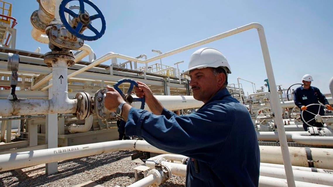 In this May 31, 2009 file photo, an employee works at the Tawke oil fields in the semiautonomous Kurdish region in northern Iraq. Iraq's self-ruled northern Kurdish region said Friday that it has made its first oil shipment through its own pipeline to the international market, bypassing the central government in Baghdad, which insists that it has the sole right to develop and market the country's natural resources. (AP Photo/Hadi Mizban, File)