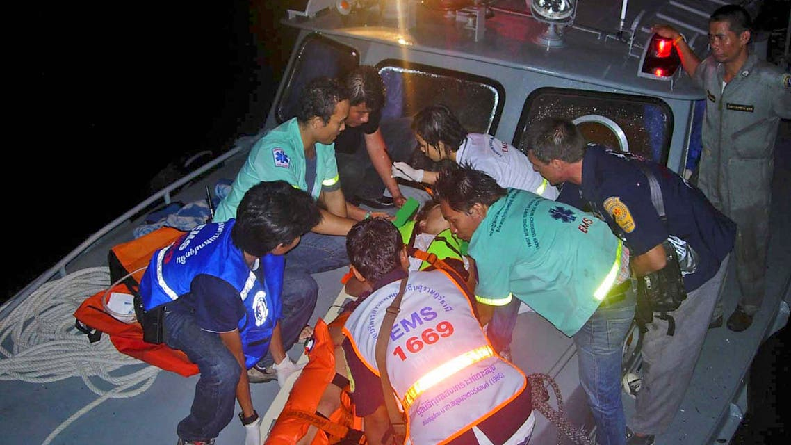 Thai rescue workers attend to an injured tourist Sunday, June 27, 2010, ap