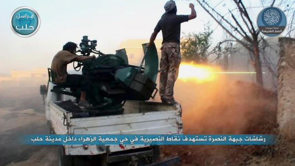 In this image posted on the Twitter page of Syria's al-Qaida-linked Nusra Front on early Tuesday, July 7, 2015, fighters from the Nusra Front fire their weapons against the Syrian government forces at the western Zahra neighborhood in Aleppo city, Syria. Opposition fighters and Islamic militants have launched a series of attacks in Aleppo since last week, capturing the city's Scientific Research Center that was used as a military base. Activists said Syrian troops and pro-government gunmen have been trying to retake the base with no luck so far. (Al-Nusra Front via AP)