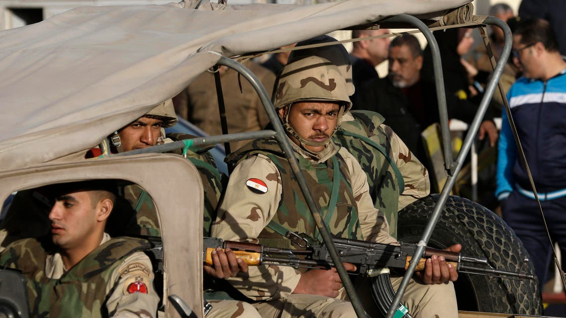 In this Jan. 30, 2015 file photo, Egyptian military police stand guard at the Almaza military airport AP