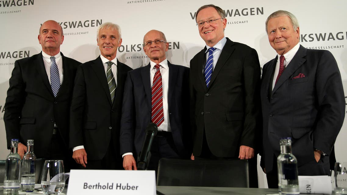 Newly appointed Volkswagen CEO Matthias Mueller, second from left, poses for a photograph with, from left, Bernd Osterloh, head of the workers' council, Berthold Huber, acting chairman of the supervisory board,, Stefan Weil, governor of German state Lower-Saxony and member of the supervisory board, and Wolfgang Porsche, member of the supervisory board. (AP)