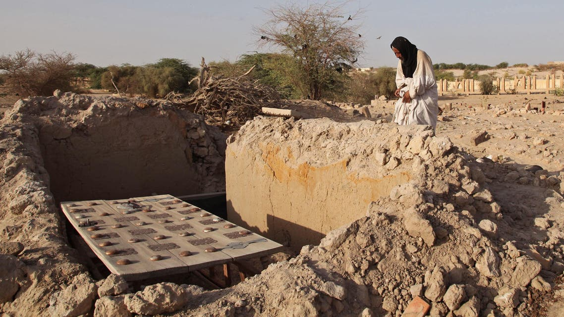 In this Friday, April 4, 2014 file photo, Mohamed Maouloud Ould Mohamed, a mausoleum caretaker, prays at a damaged tomb in Timbuktu, Mali. In the West African nation of Mali, Islamic radicals in 2012 overran Timbuktu, the historic city of Islamic culture. ap