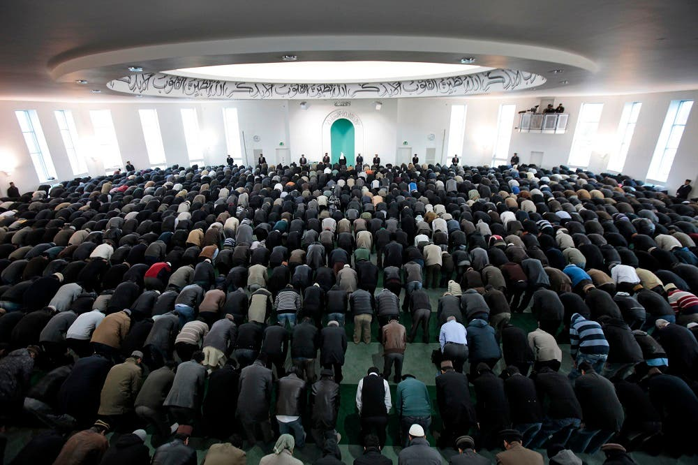 Worshippers from the Ahmadiyya Muslim community attend Friday prayers at the Baitul Futuh Mosque in south London, Friday, Feb. 18. 2011. According to the community, a sect of Islam that was founded in 1889 and represented in more than 180 countries, the mosque is the largest in western Europe. (AP Photo/Lefteris Pitarakis)