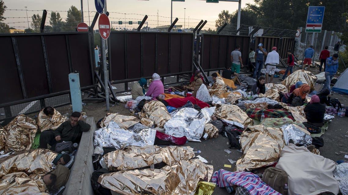 Migrants rest en route to Europe