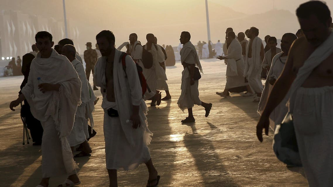 Muslim pilgrims arrive to cast stones at pillars symbolizing Satan during the annual haj pilgrimage in Mina on the first day of Eid al-Adha, near the holy city of Mecca