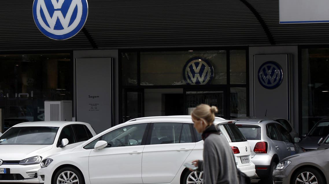 A woman walks by a Volkswagen dealer in Milan, Italy, Sunday, Sept. 27, 2015.  (AP)
