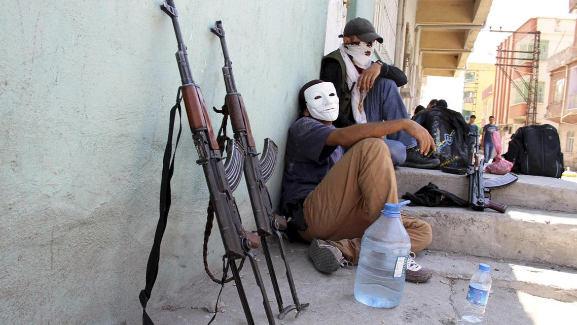 Masked members of YDG-H, youth wing of the outlawed Kurdistan Workers Party (PKK), sit next to their weapons in Silvan, near the southeastern city of Diyarbakir, Turkey, in this August 17, 2015 file photo. Young, urban-based fighters, many of them still teenagers, have taken centre-stage in the conflict between Kurdish militants and Turkish security forces that has flared anew in southeast Turkey since a two-year ceasefire fell apart in July. The intensity of the violence recalls for some the 1990s, when the insurgency waged by the PKK was at its peak and thousands were being killed annually, though the death toll remains for now well below those levels. The fighters from the PKK's youth wing, known as the 'Patriotic Revolutionary Youth Movement' (YDG-H), attack security forces in cities and towns with heavy weapons, dig trenches and erect barricades down side streets. REUTERS/Sertac Kayar/Files