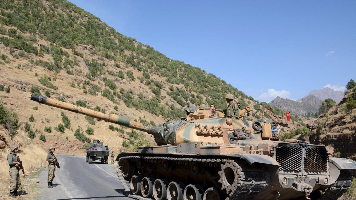 Turkish soldiers in a tank and an armored vehicle patrol on the road to the town of Beytussebab in the southeastern Sirnak province, Turkey, September 28, 2015. Five children were wounded on Monday when a bomb tore through a street in the Turkish city of Diyarbakir, hospital officials said, where deadly clashes in recent weeks have followed the collapse of ceasefire by Kurdish militants. A separate blast in the town of Tatvan wounded five soldiers when their vehicle passed over an explosive left in a ditch by the road, security sources said. The most intense fighting since the 1990s has engulfed Turkey's mainly Kurdish southeastern region since July when Ankara launched air strikes against the armed Kurdistan Workers Party (PKK) in Turkey and Iraq. More than 100 security personnel and hundreds of militants have been killed. REUTERS/Stringer