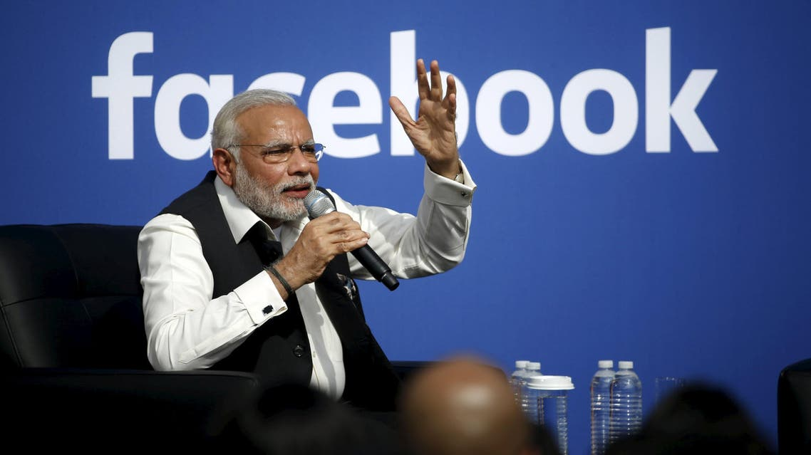 Indian Prime Minister Narendra Modi speaks on stage during a town hall at Facebook's headquarters in Menlo Park, California September 27, 2015. REUTERS/Stephen Lam