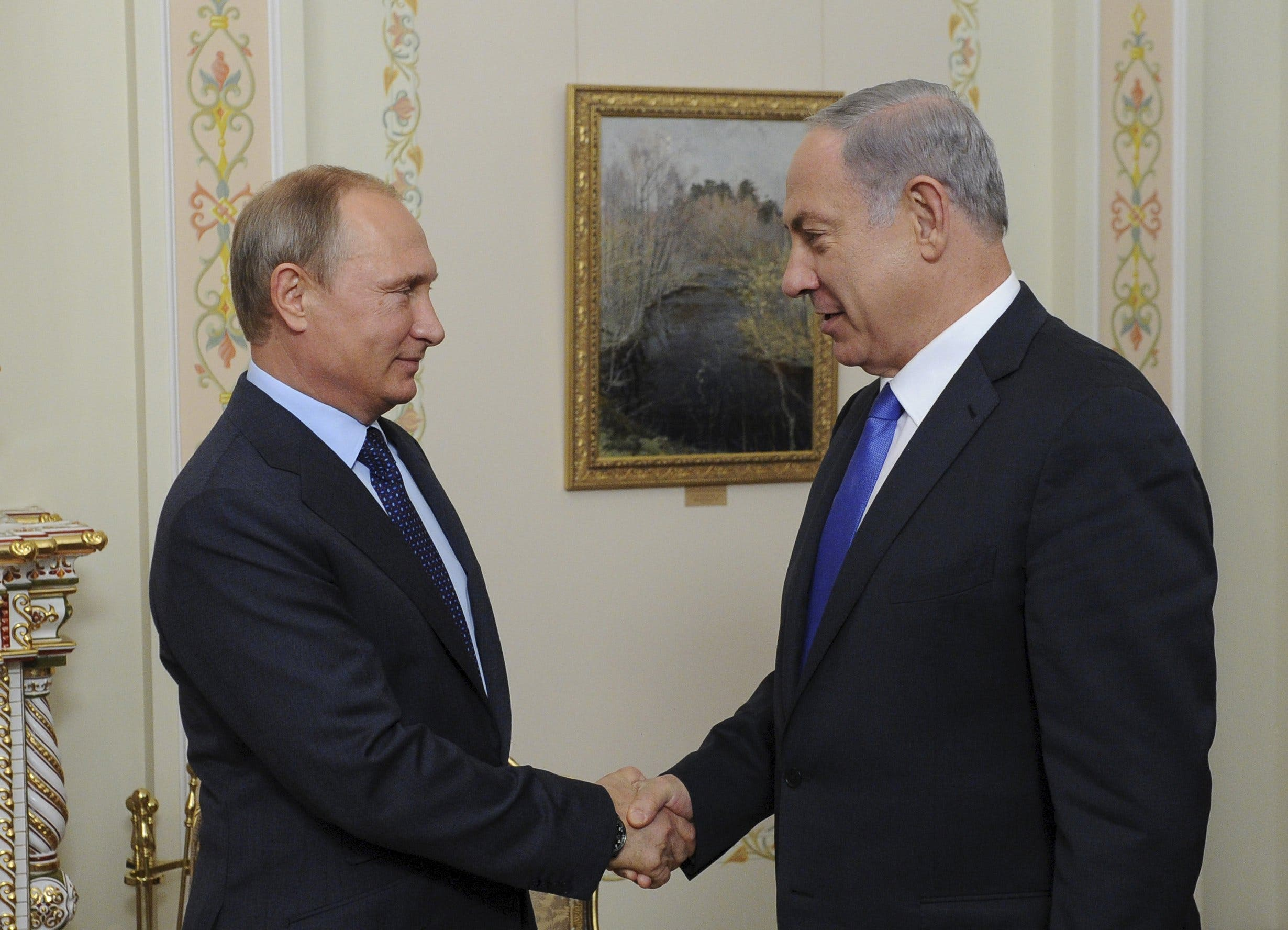 Did the russians just invade syria al arabiya english russian president vladimir putin l and israeli prime minister benjamin netanyahu shake hands during their meeting at the novo ogaryovo state residence kristyandbryce Images