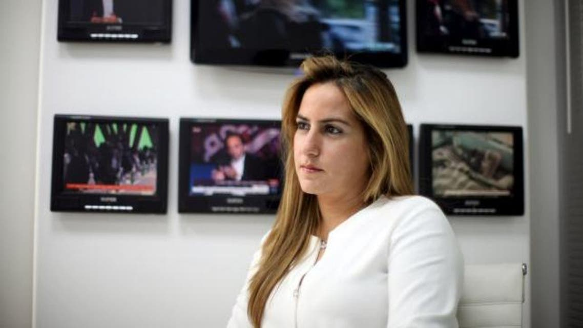 Karma Khayat, vice president of Al-Jadeed television sits during an interview with Reuters.