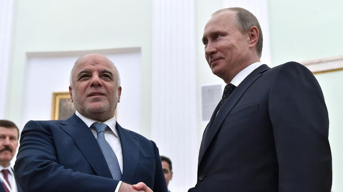 Russian President Vladimir Putin, right, shakes hands with Iraqi Prime Minister Haydar al-Abadi during their meeting in the Kremlin in Moscow. (File photo: AP)